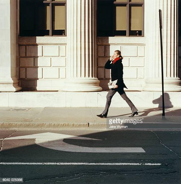 Woman Walking by Columns