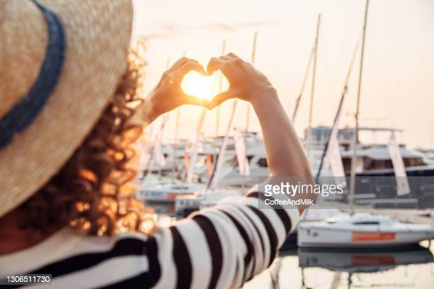 woman walking by the marina - marina stock pictures, royalty-free photos & images