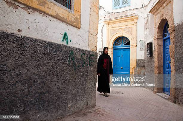 Woman walking by the streets of the medina