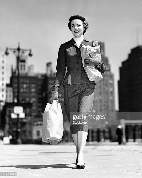 Woman walking, carrying bag