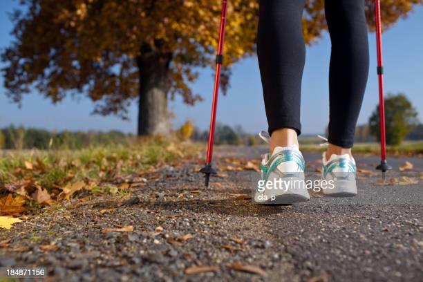 Frau cross country trail walking