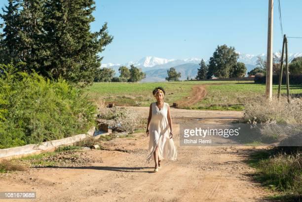 Woman walking down a footpath