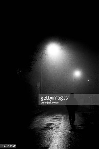 woman walking down middle of street at night, turkey, istanbul - ominous stock photos and pictures