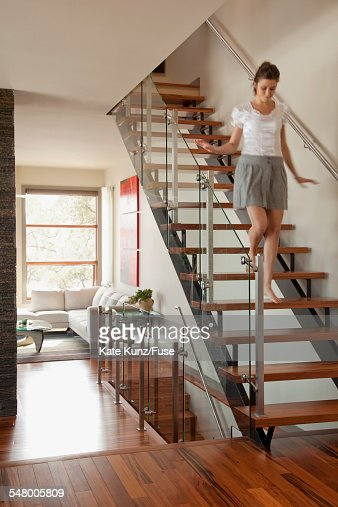 woman walking down stairs stock photo