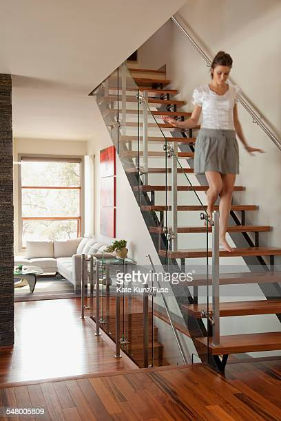 Woman walking down stairs