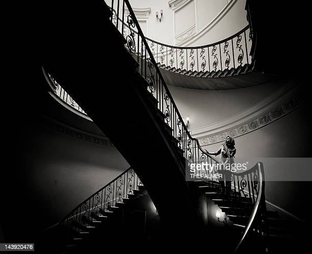 woman walking down the stairs - film noir style stock pictures, royalty-free photos & images