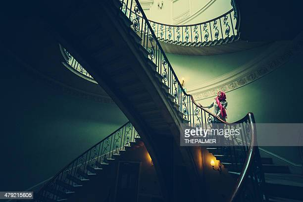 woman walking down the stairs - film noir style stock photos and pictures