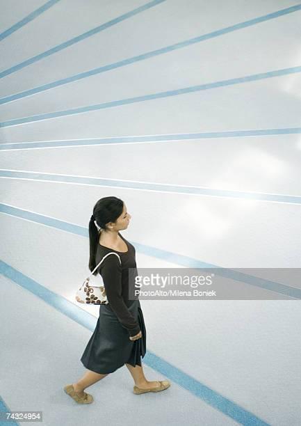 woman walking, full length, high angle view - 斜めから見た図 ストックフォトと画像