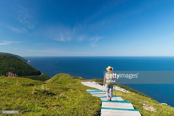 woman walking, hiking, skyline, cabot trail, cape breton, nova scotia - nova scotia stock pictures, royalty-free photos & images