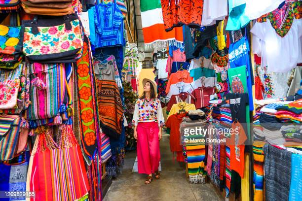 woman walking in a colorful market, guanajuato city, mexico - tourist stock pictures, royalty-free photos & images