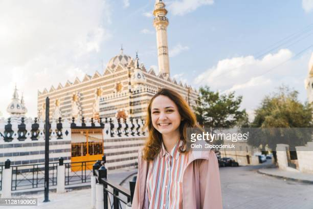 woman walking in amman - amman stock pictures, royalty-free photos & images