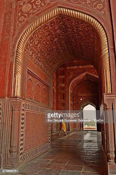 woman walking in archway of taj mahal - interior of taj mahal stock pictures, royalty-free photos & images