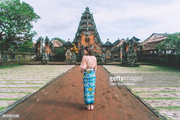 woman walking in balinese temple - traditional ceremony stock pictures, royalty-free photos & images