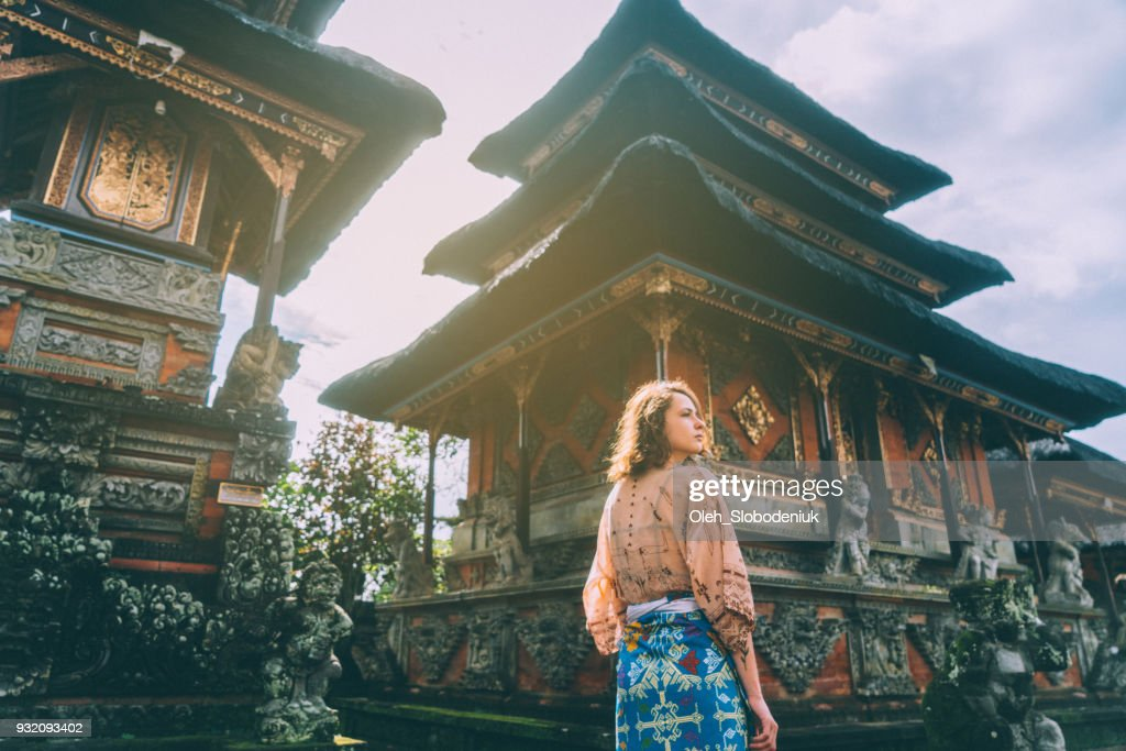 Woman walking in Balinese temple : Stock Photo