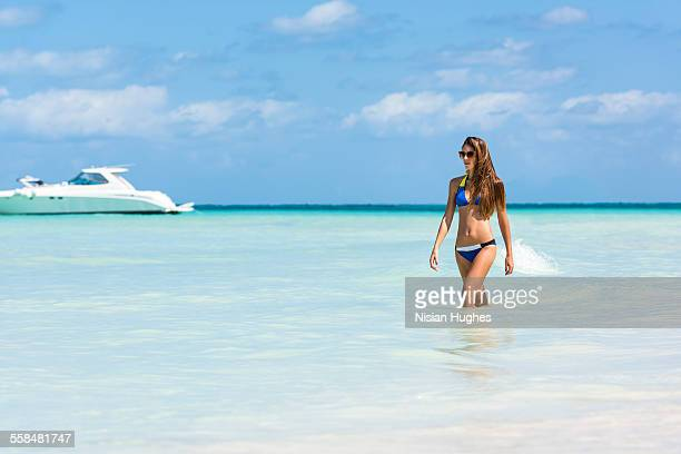 woman walking in beautiful blue ocean - hot women on boats stock pictures, royalty-free photos & images