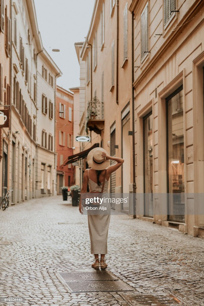 Woman walking in bologna : Stock Photo