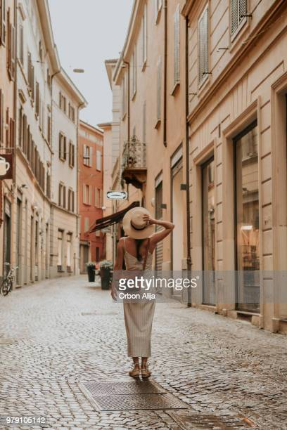 woman walking in bologna - rome italy stock pictures, royalty-free photos & images