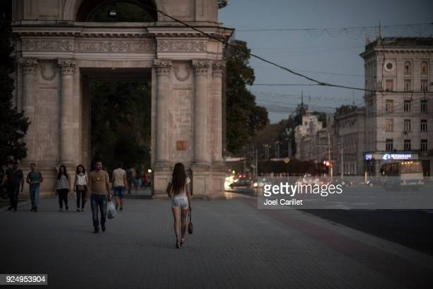 woman walking in chisinau, moldova - chisinau stock pictures, royalty-free photos & images
