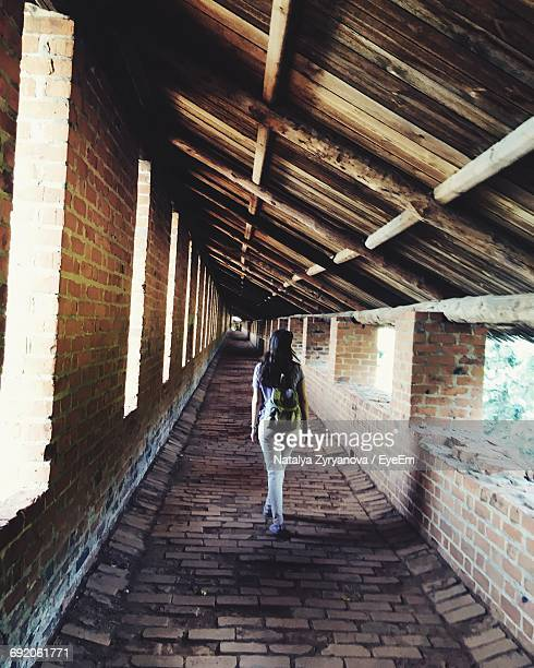 woman walking in corridor of abandoned building - nizhny novgorod oblast stock photos and pictures