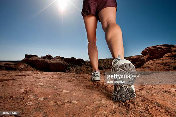 woman walking in desert - striding stock pictures, royalty-free photos & images