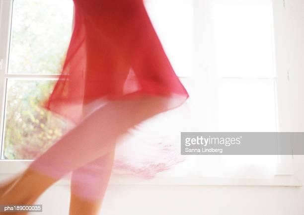 woman walking in front of window, lower section, blurred motion. - overheadprojector stockfoto's en -beelden