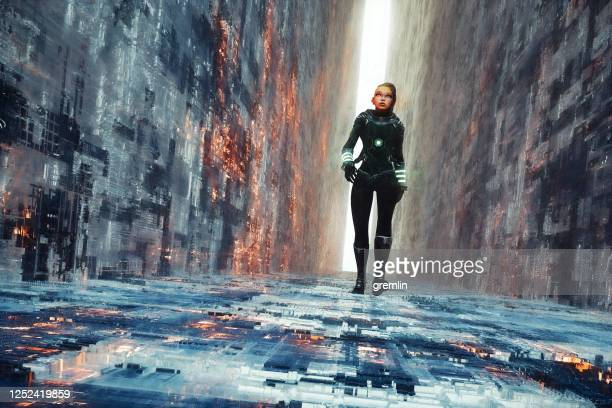 woman walking in futuristic narrow street - fictional character stock pictures, royalty-free photos & images
