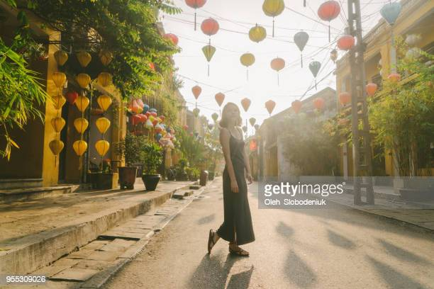 woman walking in hoi an in the morning - vietnam stock pictures, royalty-free photos & images