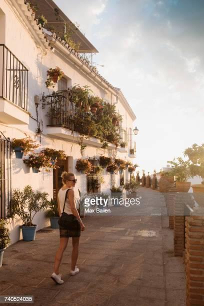 woman walking in mijas pueblo, andalucia, spain - málaga málaga province stock pictures, royalty-free photos & images