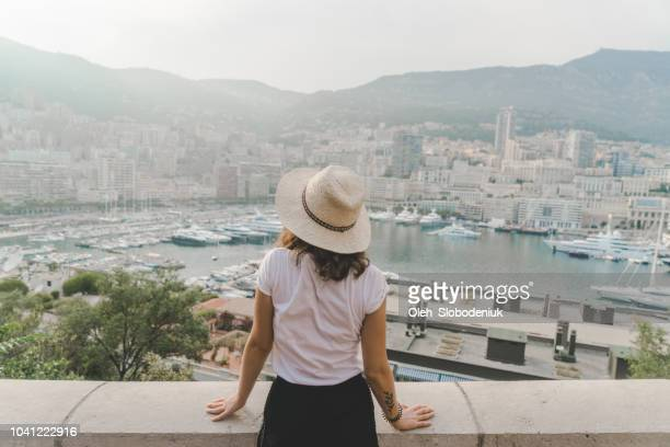 woman walking in monte carlo, monaco - monaco stock pictures, royalty-free photos & images