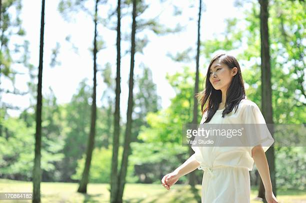 woman walking in nature - 若い女性一人 ストックフォトと画像