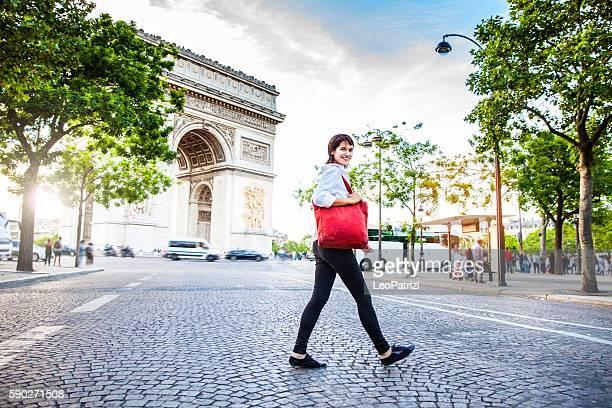 Woman walking in Paris, Arc de Triomphe surrounding area