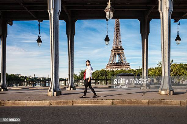 Woman walking in Paris in the Eiffel Tower surrounding area
