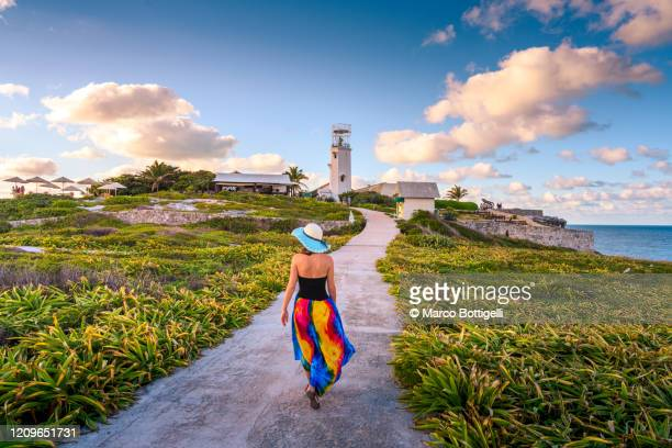 woman walking in punta sur, isla mujeres, mexico - cancun stock pictures, royalty-free photos & images