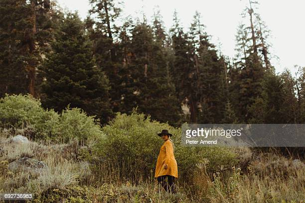 Woman walking in rural setting, Mineral King, Sequoia National Park, California, USA