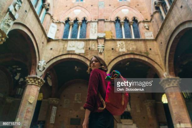 woman walking in siena - siena italy stock pictures, royalty-free photos & images