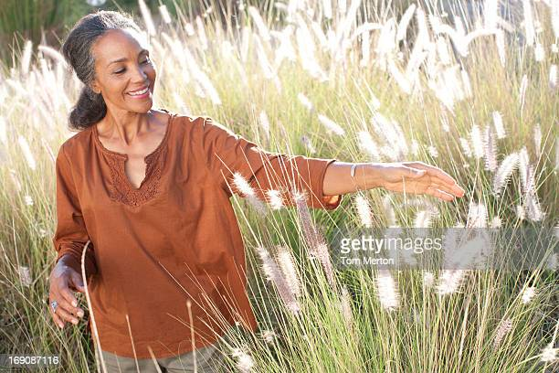 Woman walking in sunny field