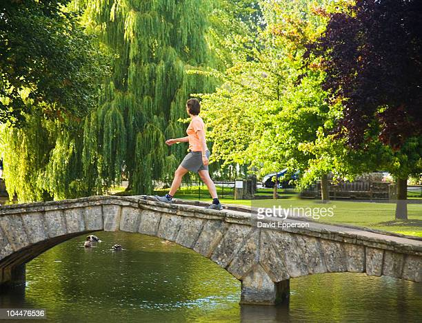 woman walking in the cotswolds - stow on the wold stock pictures, royalty-free photos & images