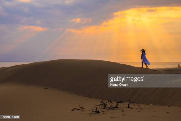 woman walking in the desert. patara. - kas stock pictures, royalty-free photos & images