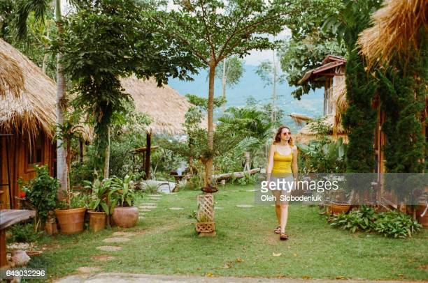 Woman walking in the front yard