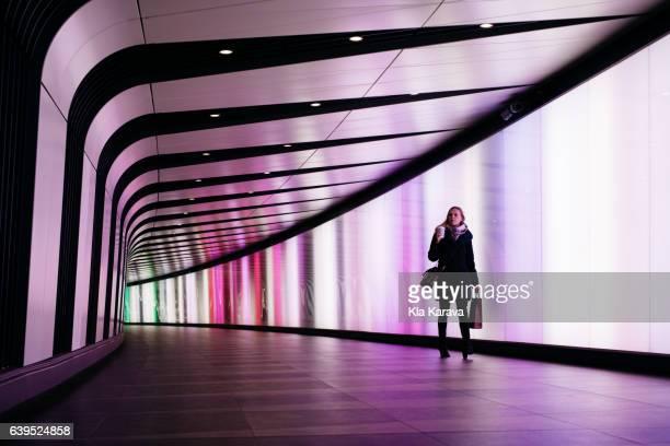 A woman walking in the Kings Cross Light Tunnel