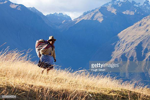 woman walking in the mountains near the archaeological site of moray, near cusco. peru. - hugh sitton fotografías e imágenes de stock