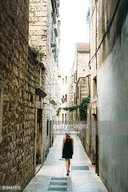 Woman walking in the old town