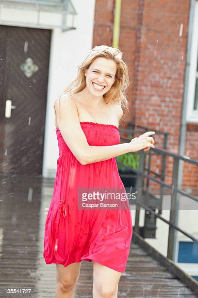 a woman walking in the rain - strapless dress stock pictures, royalty-free photos & images