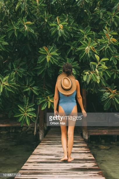 woman walking in the rainforest - lagoon stock pictures, royalty-free photos & images