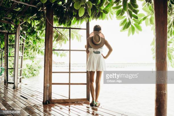 woman walking in the rainforest - green hat stock pictures, royalty-free photos & images