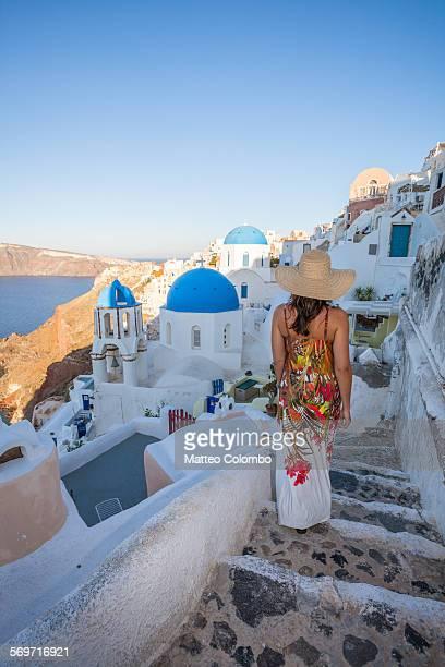 Woman walking in the streets of Oia, Santorini