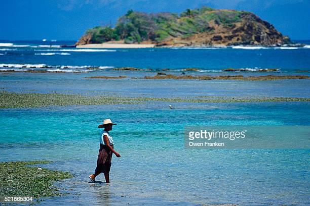 woman walking in the surf on martinique - isla martinica fotografías e imágenes de stock
