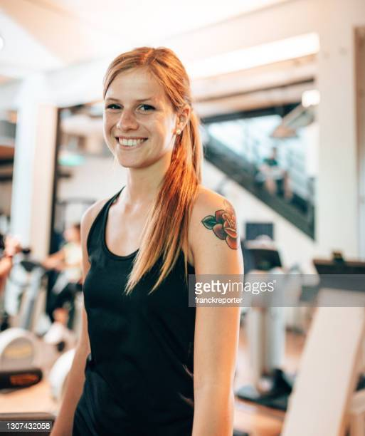 woman walking in the treadmill - waist up stock pictures, royalty-free photos & images