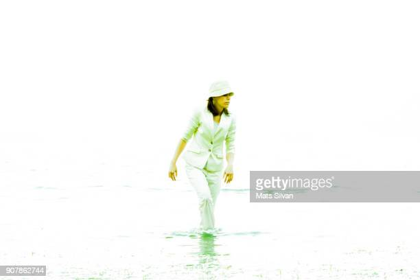 Woman Walking in the Water