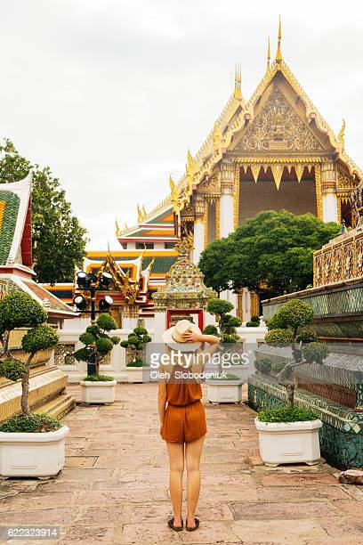 woman walking in wat pho temple - wat pho stock pictures, royalty-free photos & images